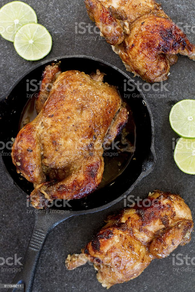 cornish hen with limes stock photo