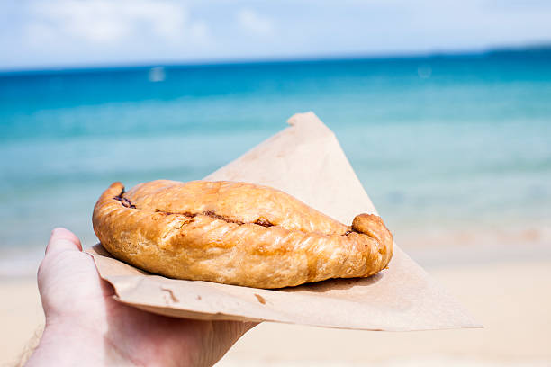 cornish pasty at the beach in st ives cornwall - cornwall stock pictures, royalty-free photos & images