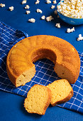 istock Cornmeal cake on a blue background. Brazilian traditional food 1227233679