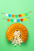 istock Cornmeal cake with popcorn and party flags. Festa Junina celebration 1227233789
