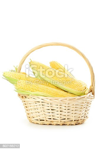 Corns in basket on a white background