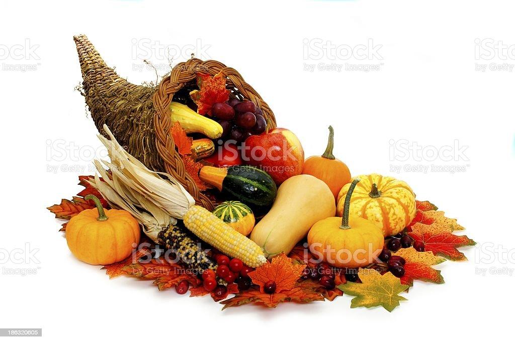 Cornucopia filled with autumn vegetables over white stock photo