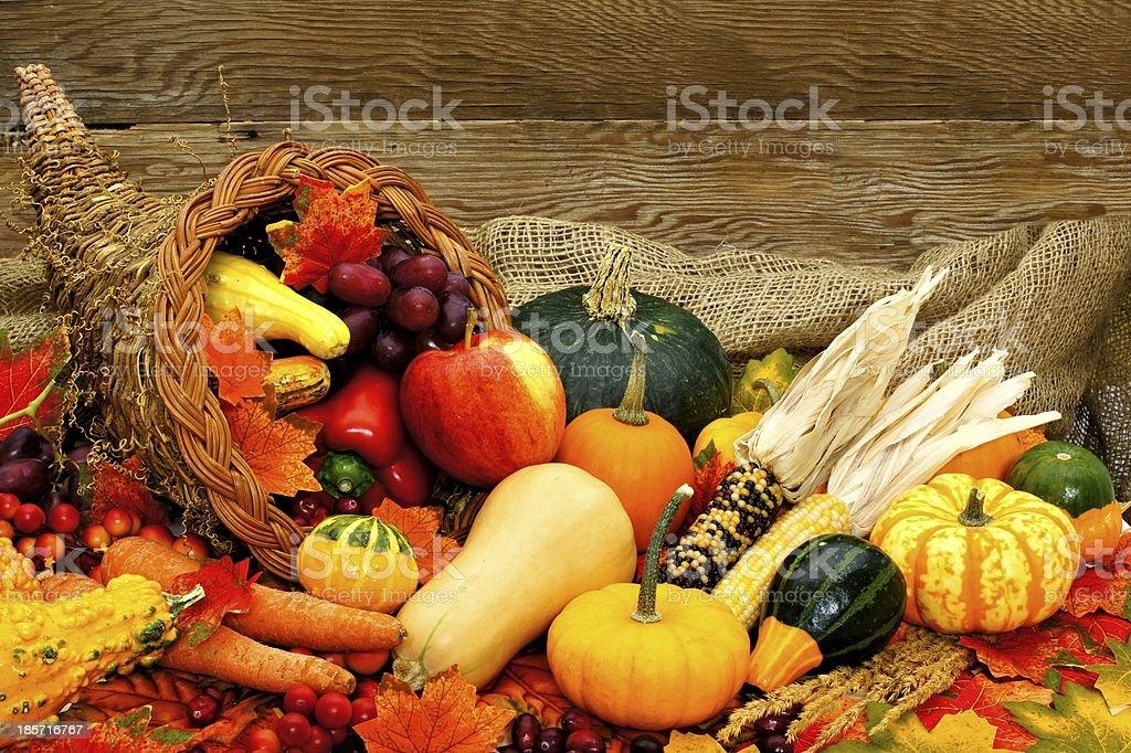 Cornucopia of autumn vegetables with wood background stock photo