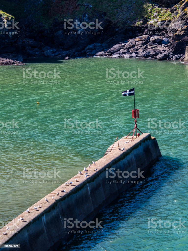 Cornwall flag on jetty stock photo