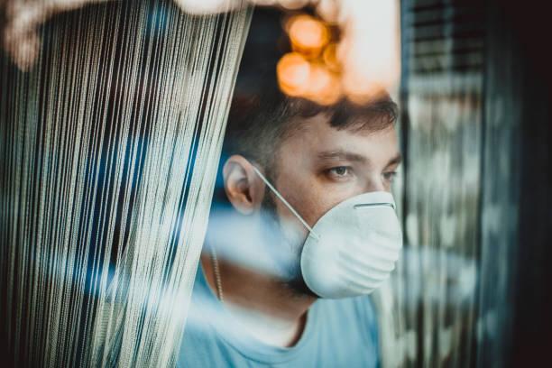 corona, patient isolation - hand on glass covid foto e immagini stock