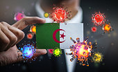 istock Corona Virus Around Algeria Flag. Concept Pandemic Outbreak in Country 1217929394