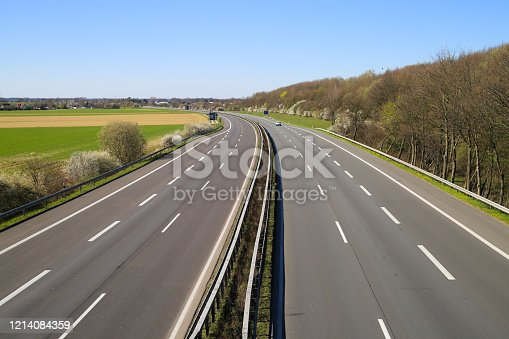 Corona virus crisis stay at home and curfew concept: no traffic on deserted empty german highway A61
