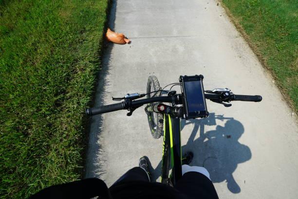 Corona Virus (COVID-19) - Houston Lockdown, Getting Fresh Aire - Break during Bike Ride - Flat Tire stock photo
