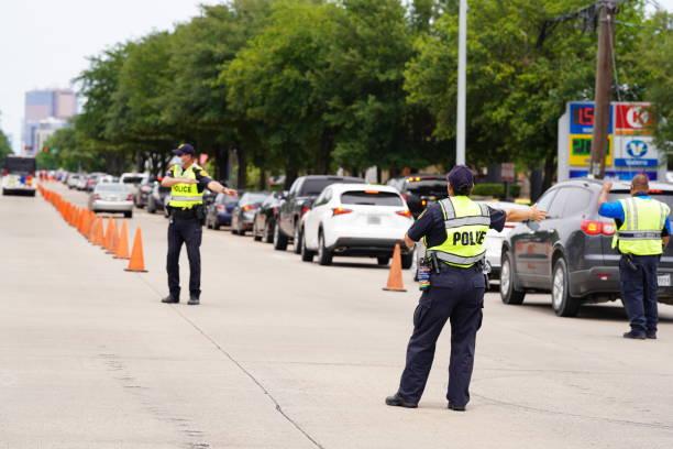 Corona Virus (COVID-19) - Houston Lockdown, Law Enforcement Work Essential Business during Lockdown stock photo