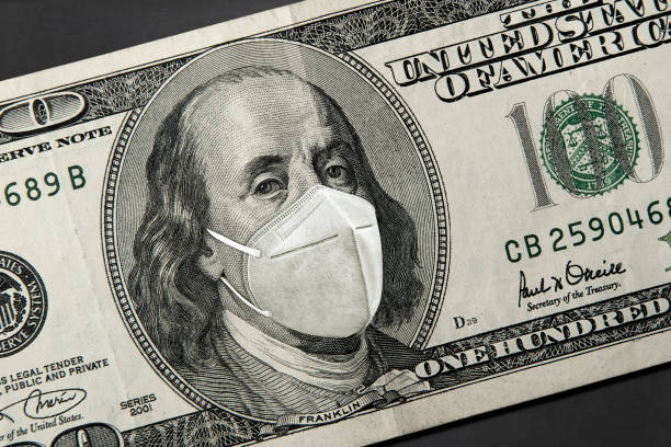 Corona Virus In United States American President with a face mask against CoV Corona Virus infection. us paper currency stock pictures, royalty-free photos & images