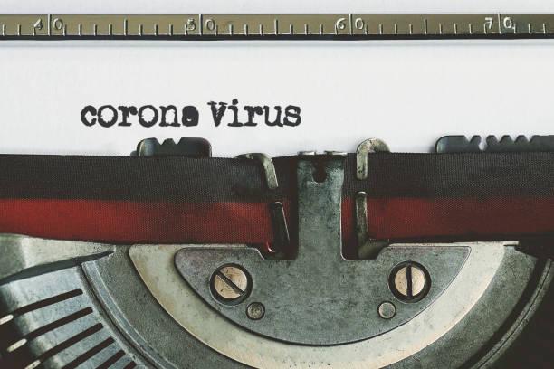 Corona Virus typed words on a vintage typewriter. corona virus-covid 19 stock photo