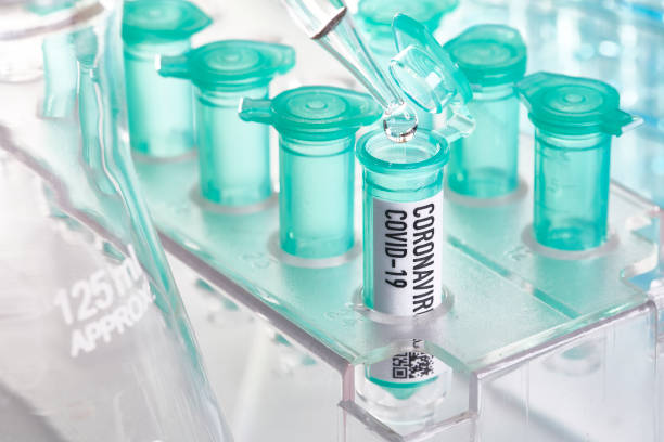 Corona virus: vial with pipette in laboratory stock photo