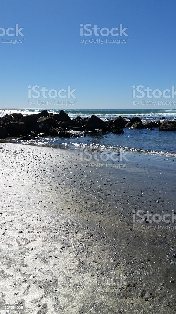 Coronado Beach Sand, Waves, Stones stock photo