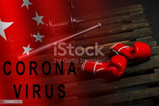 istock coronavirus and boxing gloves, sports 1205832310