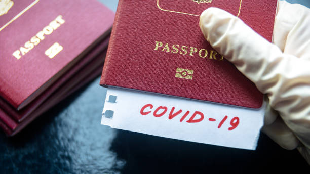 Coronavirus and travel concept. Note COVID-19 coronavirus and passport. Novel corona virus outbreak. Spread of epidemic from China. stock photo