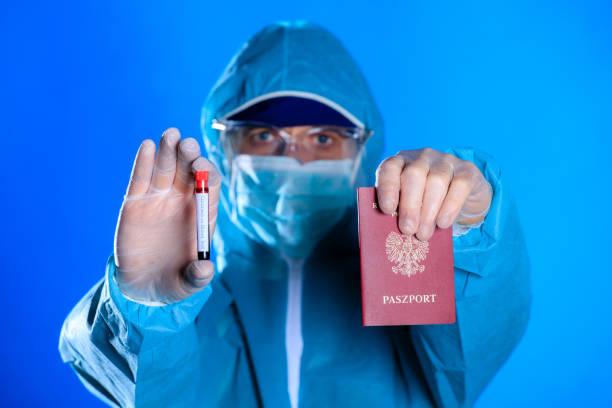 Coronavirus and travel concept. test tube with blood for analyzing VCOVID-19 coronavirus and passport. Novel corona virus outbreak. Epidemic in Wuhan, China. – zdjęcie