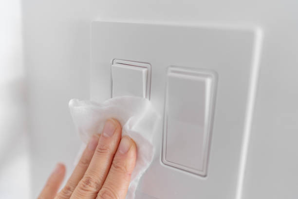 Coronavirus cleaning and disinfection recommentation guidelines: clean and disinfect high-touch household surfaces: tables, chairs, doorknobs, light switches, remotes, handles, desks, toilets, sinks stock photo