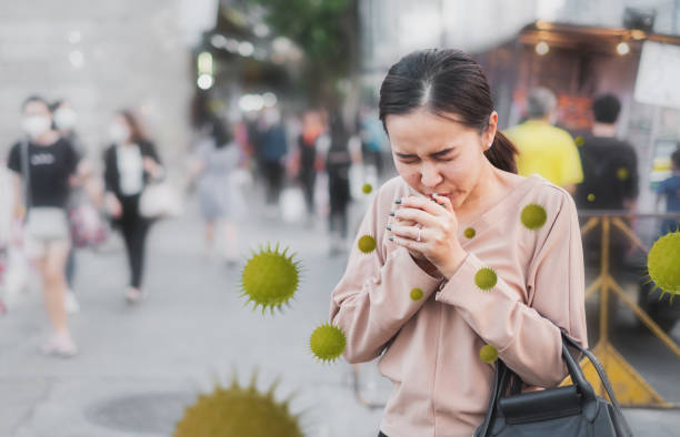 Coronavirus covid-19 concept, Unhealthy Asian woman sneezing and cough without protective face mask, ill, sick, from virus and air pollution PM2.5 stock photo