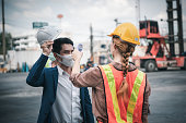 istock Coronavirus Covid-19 Disease Epidemic Crisis Situation, Construction Worker Having Fever Body Scan by Thermometer Scanning at Construction Site. Corona-Virus Covid19 Prevention of New Normal Concept 1226029448
