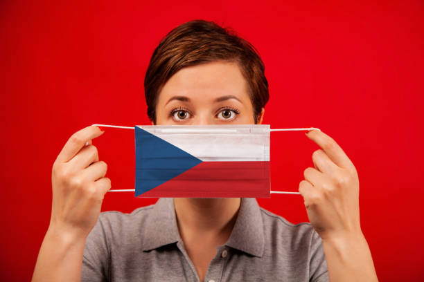 Coronavirus COVID-19 in the Czech Republic. Woman in medical protective mask with the image of the Czech Republic flag. stock photo