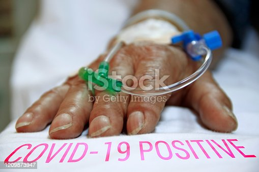 Coronavirus covid-19 infected patient's hand closeup