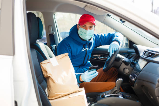 Coronavirus Covid-19 infection.masked delivery man, epidemic stock photo