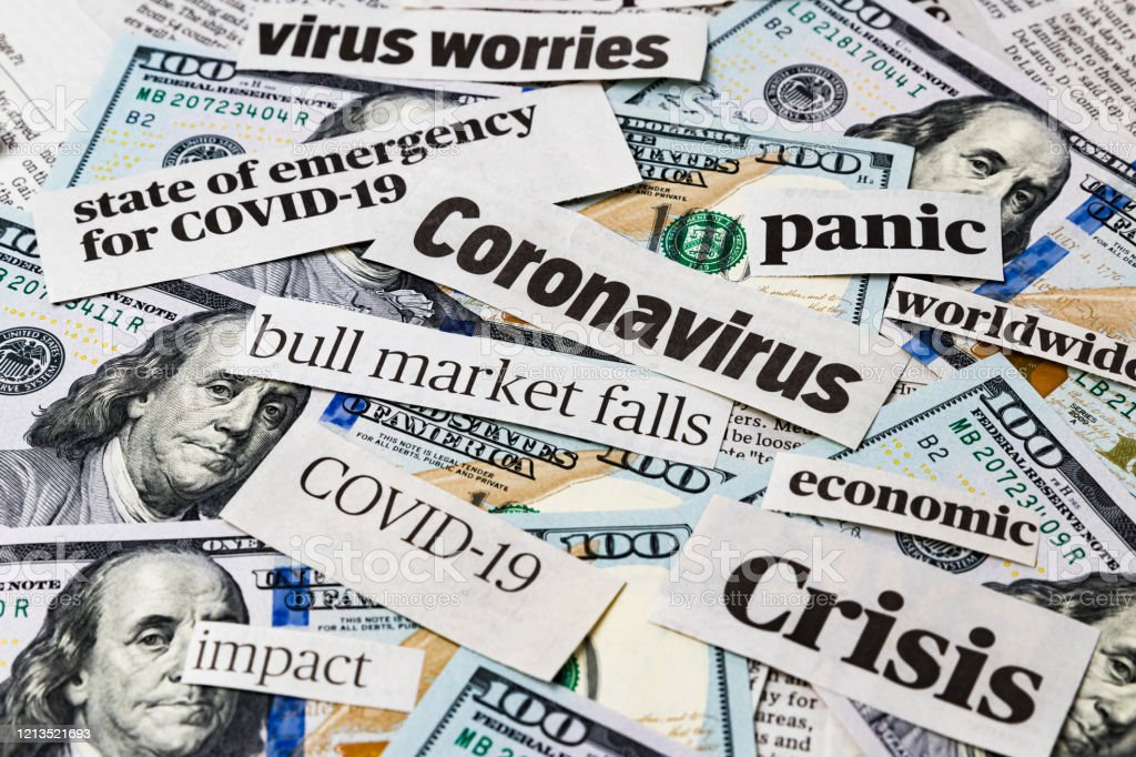 Coronavirus, covid-19 news headlines on United States of America 100 dollar bills. Concept of financial impact, stock market decline and crash due to worldwide pandemic - Royalty-free Accidents and Disasters Stock Photo