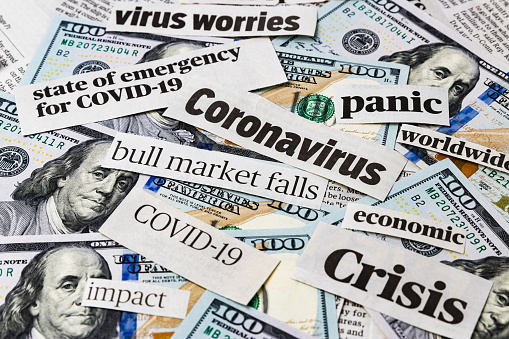 istock Coronavirus, covid-19 news headlines on United States of America 100 dollar bills. Concept of financial impact, stock market decline and crash due to worldwide pandemic 1213521693