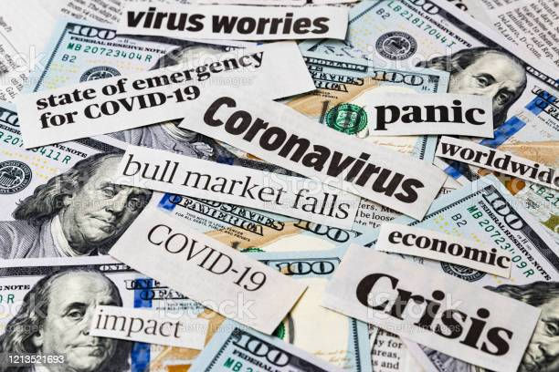 Coronavirus Covid19 News Headlines On United States Of America 100 Dollar Bills Concept Of Financial Impact Stock Market Decline And Crash Due To Worldwide Pandemic Stock Photo - Download Image Now
