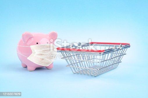 Coronavirus covid-19 piggy bank mask online shopping blue background