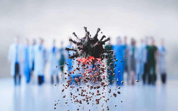Coronavirus defeated by doctors and scientists. Virus breaking up into pieces stock photo