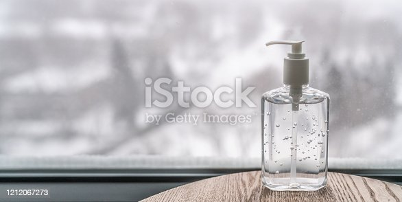 istock Coronavirus hand sanitizer gel to wash hands for flu virus prevention. Alcohol based antimicrobial disinfectant product for airport, hospital, healthcare and home panoramic banner background 1212067273