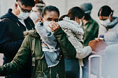 Shot of a group of young people wearing masks while travelling in a foreign city