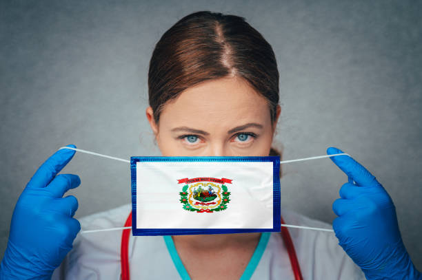 Coronavirus in U.S. State West Virginia, Female Doctor Portrait, protect Face surgical medical mask with West Virginia Flag. Illness, Virus Covid-19 in West Virginia Coronavirus in U.S. State West Virginia, Female Doctor Portrait, protect Face surgical medical mask with West Virginia Flag. Illness, Virus Covid-19 in West Virginia west virginia us state stock pictures, royalty-free photos & images