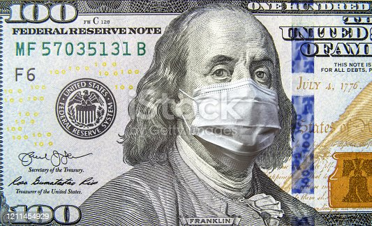 istock COVID-19 coronavirus in USA, 100 dollar money bill with face mask. Coronavirus affects global stock market. 1211454929
