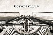 Coronavirus on a typewriter type text on old vintage paper. Epidemic virus
