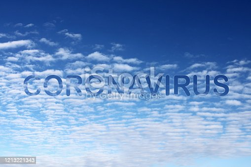 Coronavirus on the air spreading globally appears on blue sky and clouds