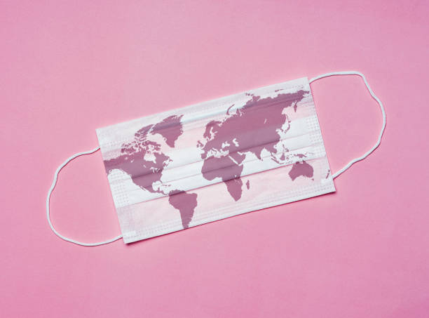 Coronavirus outbreak, Covid-19 Concept, World map on a surgical face mask stock photo