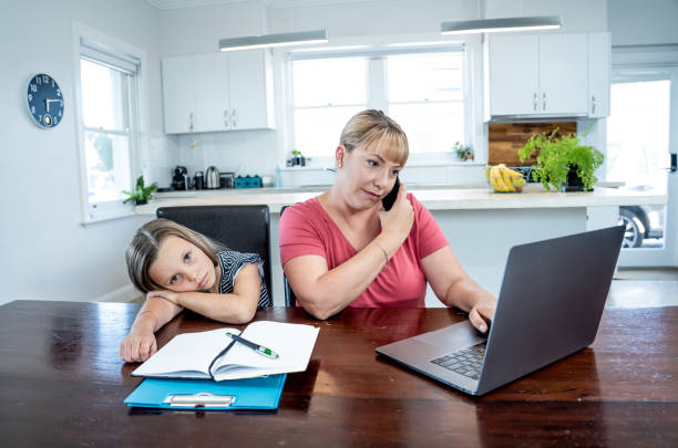 coronavirus outbreak schools and offices closing. stressed mother coping with remote work and bored daughter. covid-19 shutdowns and quarantines forces parents to work from home and homeschooling. - remote work imagens e fotografias de stock