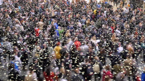 Coronavirus particles in a crowd of people. stock photo