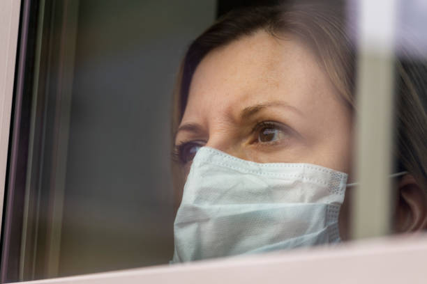 coronavirus (covid-19) patient self quarantined at home medical mask - mphillips007 stock pictures, royalty-free photos & images