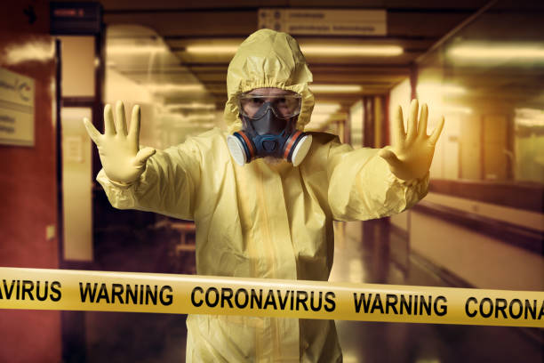 Coronavirus Coronavirus Warning cordon tape and men wearing protective suit quarantine stock pictures, royalty-free photos & images