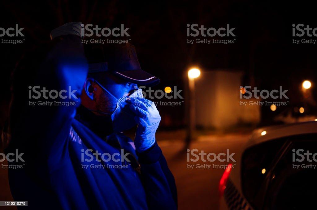 coronavirus. Police using protection methods to avoid contagion by coronavirus coronavirus. Police using protection methods to avoid contagion by coronavirus Adult Stock Photo