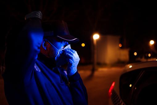 Coronavirus Police Using Protection Methods To Avoid Contagion By Coronavirus Stock Photo - Download Image Now