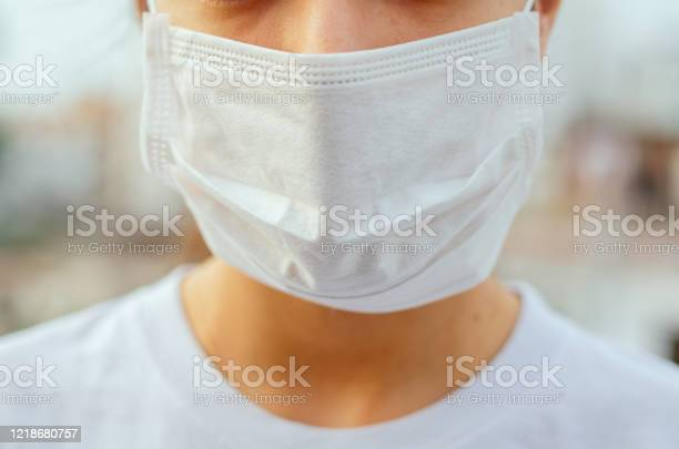 Coronavirus prevention woman with wearing surgical face mask against picture id1218680757?b=1&k=6&m=1218680757&s=612x612&h=glbstrijrfokqq lbs8bnxgivh2z5gpgjwgi78tscwo=
