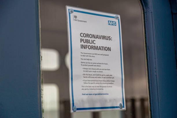 Coronavirus Public Information Poster UK Public information poster from the NHS (National Health Service) with advice relating to the COVID-19 Coronavirus medium shot stock pictures, royalty-free photos & images