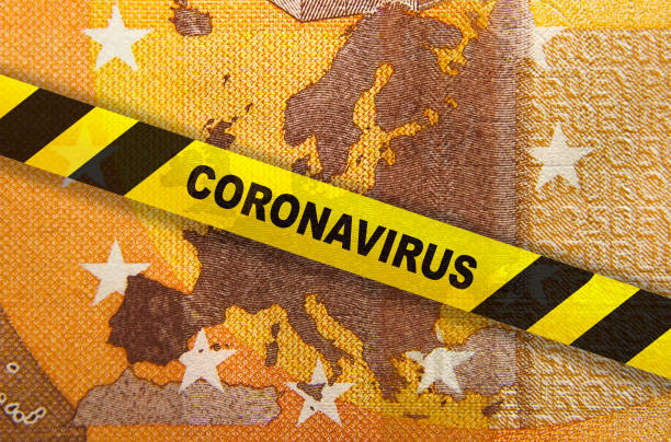 Coronavirus quarantine in Europe. Concept. 50 Euro banknote with EU map and yellow tape. Economy and financial markets affected by corona virus outbreak and pandemic fears. Digital montage. central europe stock pictures, royalty-free photos & images