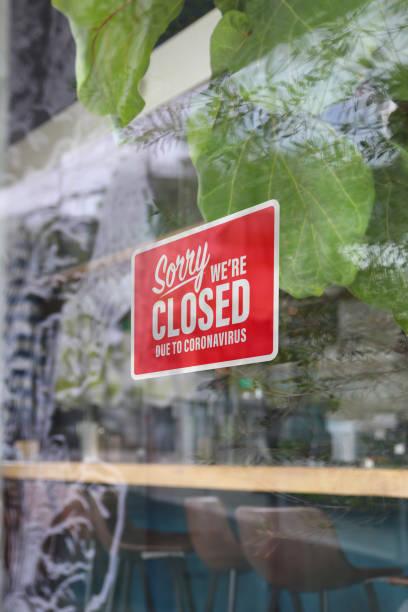 Coronavirus restaurant closed sign vertical stock photo