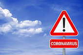 istock Coronavirus - road sign information message 1201524973