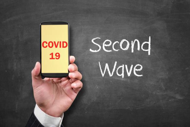 Coronavirus second wave alert message stock photo